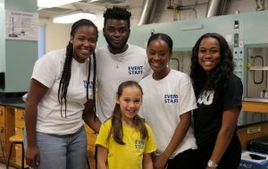 4 SDSU BSSO students pose with child at Science Sampler