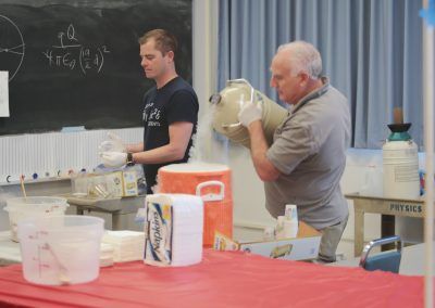 Milton pouring liquid nitrogen into a cooler.