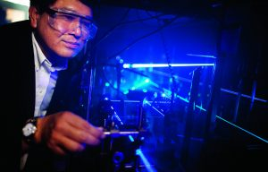 Bill Tong demonstrating laser.