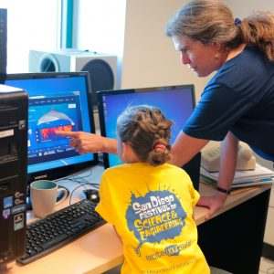 professor showing child dolphin sound waves on computer display