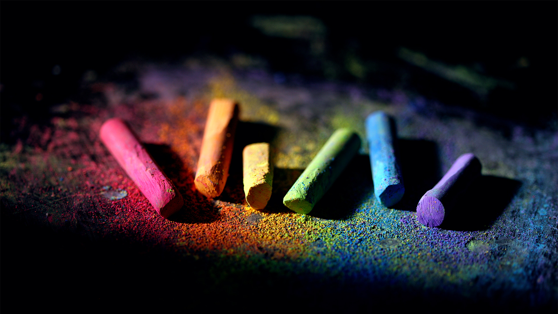 red, orange, yellow, green, blue, and violet chalk on black background.