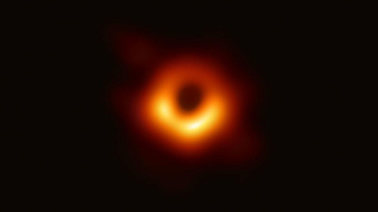 Dark Space with blurry orange ring.