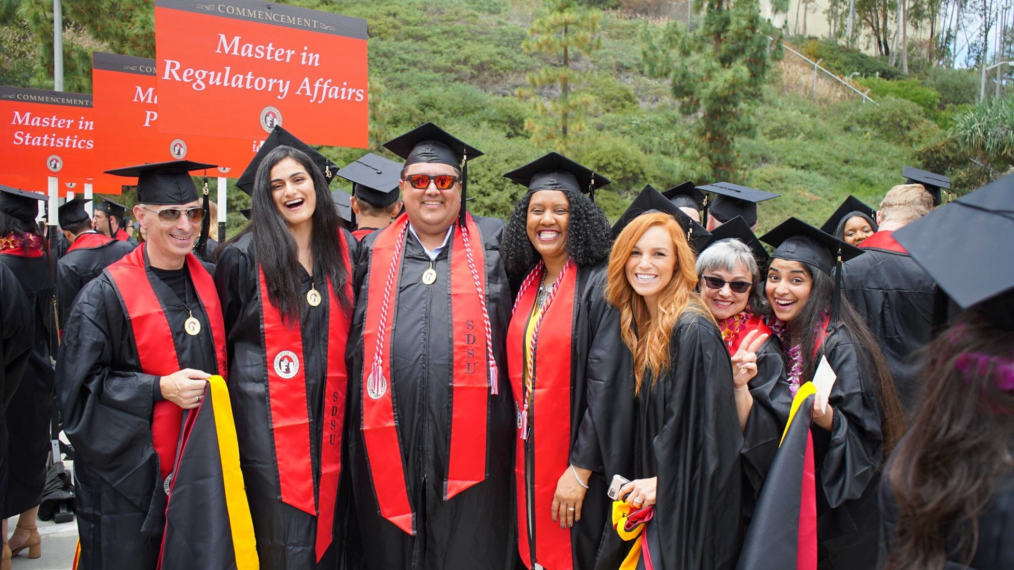 """Photo of Regulatory Affairs Graduates with a sign behind the graduates stating """"Master in Regulatory Affairs"""""""